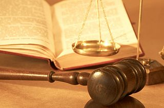 Gavel, statutes and scales of justice